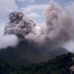 Vertical eruption column from Soufriere Hills, July 1996.