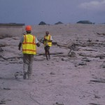 Dr Keith Rowley and personnel of Seismic research Unit studying deposits from June 25, 1997 eruption , location on outskirts of Bramble airport on east coast.